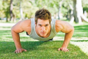 Young man doing push-ups at the park